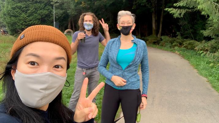 Three staff outdoors wearing masks
